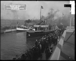 Spectators line the lock walls as the U.S. Army Corps of Engineers vessel Gladwin makes the first lockage through the Davis Lock, October 21, 1914.