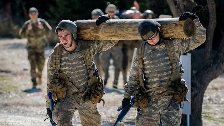 Air Force Academy cadets carry a log during a medical evacuation march at Camp Bullis, Texas, Feb. 16, 2017. Air Force photo by Airman 1st Class Daniel Snider