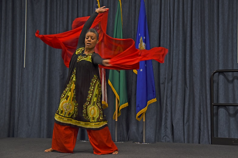Mona Martin performs a South African tribal dance during the National Black History Month luncheon Feb. 23, 2017, at Fairchild Air Force Base, Washington. The dance performed was based on the original culture musical and movement styles. A tribal dance is a type of dance used to symbolize the origin of one's connection with their culture. (U.S. Air Force photo/Senior Airman Mackenzie Richardson)