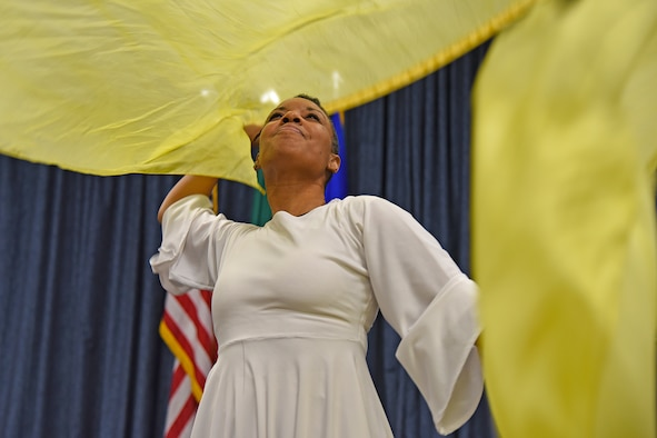 Mona Martin performs a praise dance during the National Black History Month luncheon Feb. 23, 2017, at Fairchild Air Force Base, Washington. Praise dance or liturgical dance is a type of dance incorporated into liturgies and worship services as an expression of worship to enhance the prayer or worship experience. (U.S. Air Force photo/Senior Airman Mackenzie Richardson)