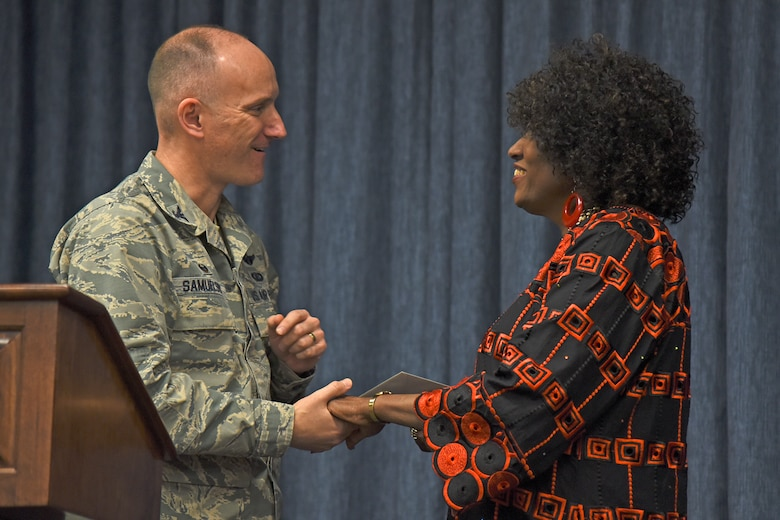 Col. Ryan Samuelson, 92nd Air Refueling Wing commander, thanks Stephanie Nobles-Beans, coordinator for Diversity, Equity and Inclusion for Campus Ministries at Whitworth University, for her contribution to the National Black History Month luncheon Feb. 23, 2017, at Fairchild Air Force Base, Washington. Nobles-Beans spoke on the importance of instilling self-confidence and knowledge of endless possibilities into education and today's youth. (U.S. Air Force photo/Senior Airman Mackenzie Richardson)