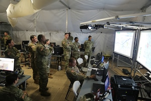 Members of various battle staff elements work to visualize their warfighting functions as part of a User Defined Operational Picture during Cyber Quest 2016 at Fort Gordon, Ga., July 20, 2016. Led by the Army Cyber Center of Excellence, the event's goal was to conduct experimentation to accelerate capabilities that address Army Warfighting Challenge #7 to 'Conduct Space, Cyber Electromagnetic Operations and Maintain Communications.' Army photo by Spc. Kiara V. Flowers