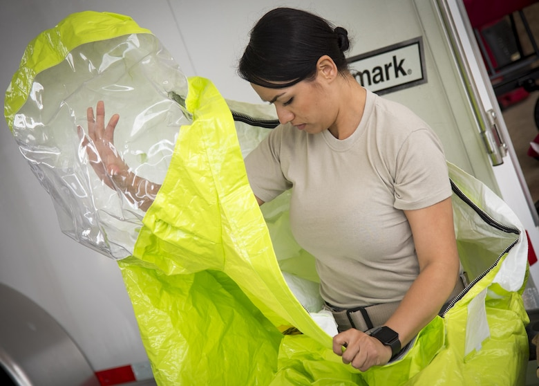 Staff Sgt. Vikki Flores, 96th Civil Engineer Group, prepares her protective suit during the hazardous material portion of an exercise Feb. 22 at Eglin Air Force Base, Fla.  The chemical, biological, nuclear response exercise tested the procedures of emergency response, explosive ordnance disposal, disaster management and bioenvironmental agencies among others.  (U.S. Air Force photo/Samuel King Jr.)