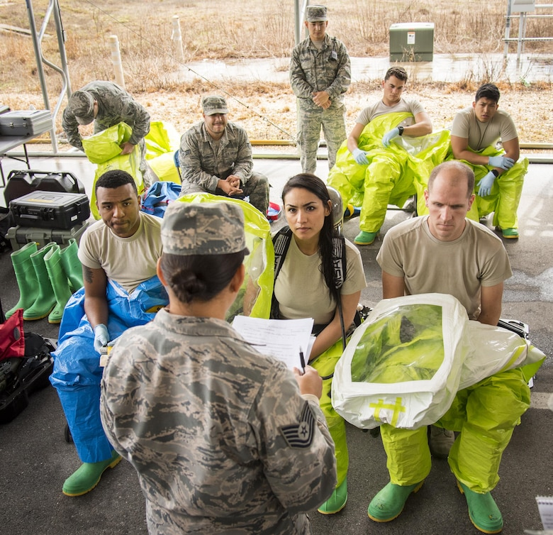 Airmen are briefed on the situation and procedures they will take during a hazardous material portion of an exercise Feb. 22 at Eglin Air Force Base, Fla.  The chemical, biological, nuclear response exercise tested the procedures of emergency response, explosive ordnance disposal, disaster management and bioenvironmental agencies among others.  (U.S. Air Force photo/Samuel King Jr.)