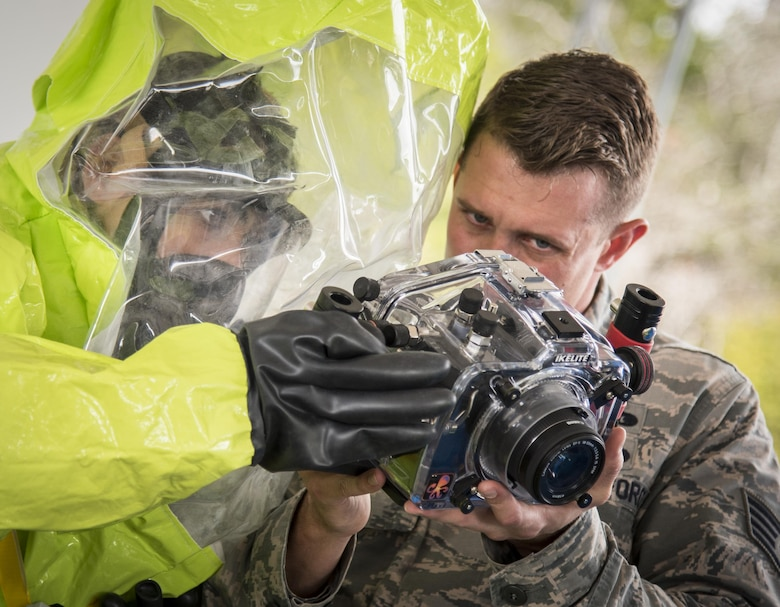 Airmen ensure the camera settings are correct during a hazardous material portion of an exercise Feb. 22 at Eglin Air Force Base, Fla.  The chemical, biological, nuclear response exercise tested the procedures of emergency response, explosive ordnance disposal, emergency management and bioenvironmental agencies among others.  (U.S. Air Force photo/Samuel King Jr.)