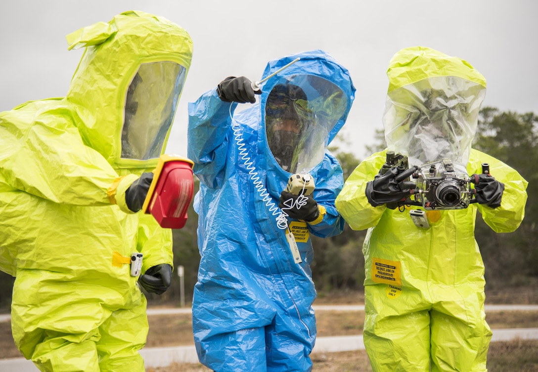 Airmen in protective suits use instruments to detect any hazardous material during an exercise Feb. 22 at Eglin Air Force Base, Fla.  The chemical, biological, nuclear response exercise tested the procedures of emergency response, explosive ordnance disposal, emergency management and bioenvironmental agencies among others.  (U.S. Air Force photo/Samuel King Jr.)