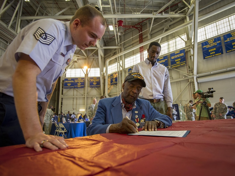 Davontre Wigfall (pictured right), a college student from Mount Pleasant, S.C., was sworn into the U.S. Air Force Reserve by an original Tuskegee Airman, (Ret.) Lt. Col. Enoch Woodhouse during the Tuskegee Airmen Career Day Feb. 23, 2017, at Joint Base Charleston, S.C. Upon graduation from basic training and tech. school, Wigfall will return to the 315th Airlift Wing as a member of the 38th Aerial Port Squadron. (U.S. Air Force photo by Senior Airman Tom Brading)