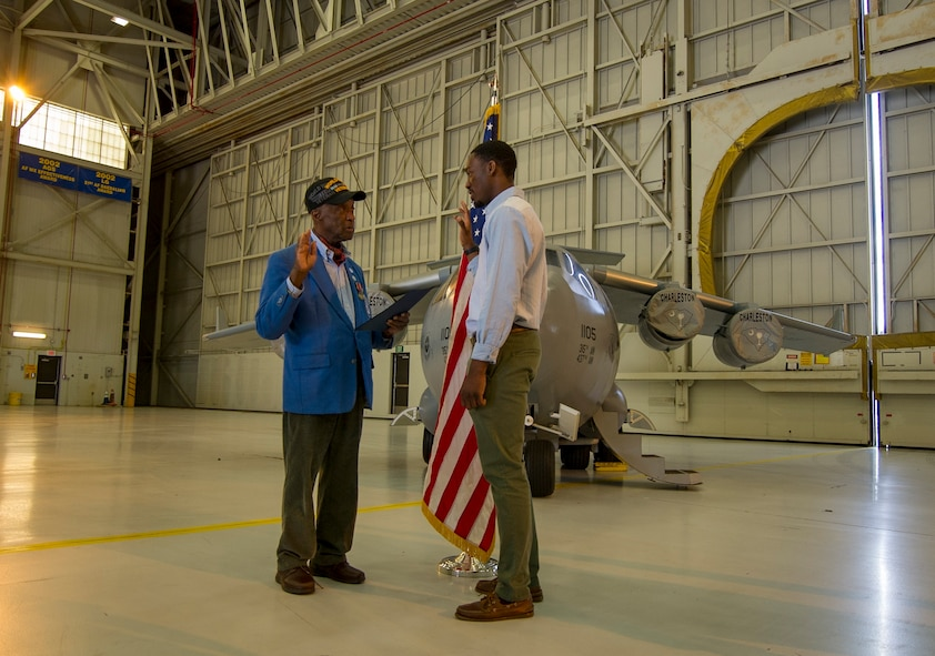 "(Ret.) Lt. Col. Enoch ""Woody"" Woodhouse, an original Tuskegee Airman, conducts the Oath of Enlistment ceremony to Davontre Wigfall, a Mount Pleasant native, Feb. 23, 2017, at Joint Base Charleston, South Carolina. Woodhouse was visited the base in conjunction with the Tuskegee Airmen Career Day. Upon graduation from basic training and tech. school, Wigfall will return to the 315th Airlift Wing as a member of the 38th Aerial Port Squadron. (U.S. Air Force photo by Senior Airman Tom Brading)"