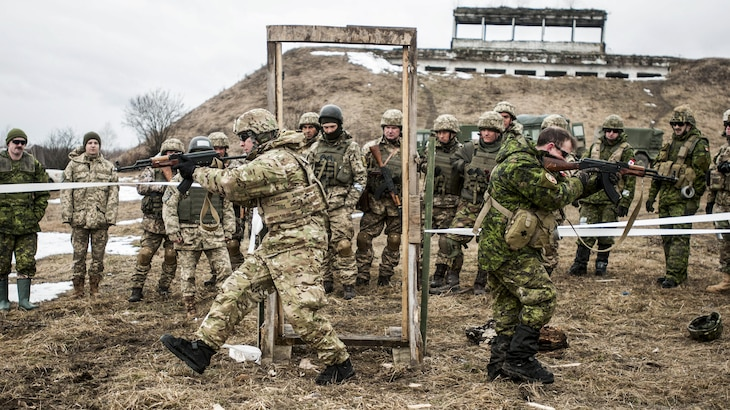 Army Staff Sgt. Uriah Gibson and a Canadian engineer show Ukrainian troops how to clear a room after breaching a door with explosives in Ukraine, Feb. 23, 2017. Army photo by Sgt. Anthony Jones