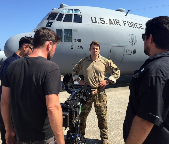 "A Fox TV camera crew shoots footage of Tech. Sgt. Ben Domian, a survival, evasion, resistance, and escape specialist with the 920th Rescue Wing, in front of a HC-130 P/N King June 15, 2016 at Patrick Air Force Base, Fla. The network shot footage of Domian to use for its newest reality show, ""Kicking and Screaming,"" which airs March. 9. Domian is one of 20 contestants on the show. (U.S. Air Force photo/Maj. Cathleen Snow)"