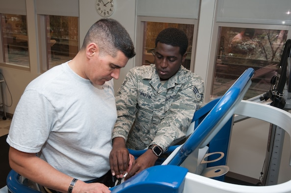 Col. Eric Shafa, 42d Air Base Wing commander, learns how to operate an Anti Gravity Treadmill during a visit to the 42d Medical Operations Squadron on Feb 21, 2017.  Senior Airman Donald Martin walked the command team through various exercises his team does daily in the physical therapy section.  (US Air Force photo by Bud Hancock)