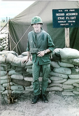 Retired Chief Master Sgt. Charles Fox, who served as an aeromedical evacuation technician in the 903rd Aeromedical Evacuation Flight stands in front of the casualty staging tents adjacent to a forward army medical facility at Duc Pho in 1967. (Contributed Photo)