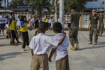 Children watch as U.S. Marines and fellow students play volleyball during a community relations visit to Ban Chong Kapad School in Chanthaburi Province, Thailand, during exercise Cobra Gold, Feb. 20, 2017. Cobra Gold, in its 36th iteration, focuses on humanitarian civic action, community engagement, and medical activities to support the needs and humanitarian interest of civilian populations around the region.