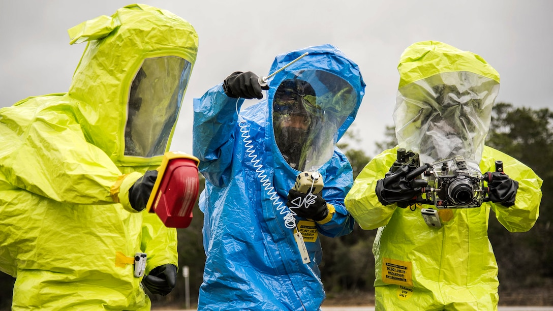 Airmen in protective suits use instruments to detect hazardous materials during a chemical, biological and nuclear response exercise at Eglin Air Force Base, Fla., Feb. 22, 2017. Air Force photo by Samuel King Jr.