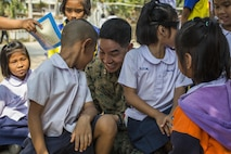 U.S. Marine Corps Capt. Jesse Lestronge, with 1st Marine Aircraft Wing, plays with Thai students during a community relations visit to Ban Chong Kapad School in Chanthaburi Province, Thailand, during exercise Cobra Gold, Feb. 20, 2017. Cobra Gold, in its 36th iteration, focuses on humanitarian civic action, community engagement, and medical activities to support the needs and humanitarian interest of civilian populations around the region.