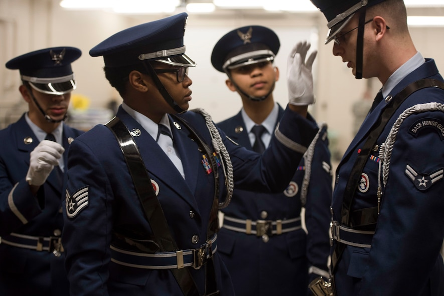 Members of the Ellsworth Honor Guard inspect each other's uniforms before presenting the colors during a performance by the Offutt Brass at the Performing Arts Center Historic Theater in Rapid City, S.D., on Feb. 22, 2017. Offutt Brass is the brass ensemble of the U.S. Air Force Heartland of America Band that performs around the U.S. to celebrate America and patriotism. (U.S. Air Force photo by Airman 1st Class Randahl J. Jenson)