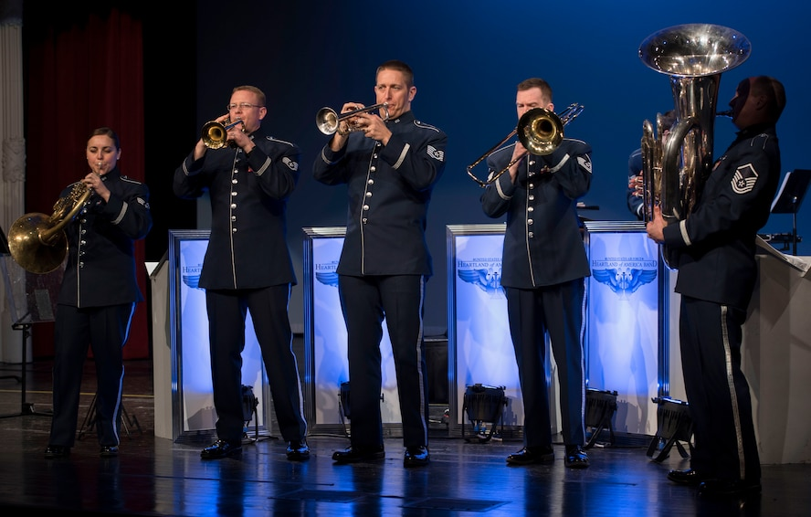 Members of Offutt Brass play the Air Force Song during a performance at the Performing Arts Center Historic Theater in Rapid City, S.D., on Feb. 22, 2017. Offutt Brass is the brass ensemble of the U.S. Air Force Heartland of America Band that performs around the U.S. to celebrate America and patriotism. (U.S. Air Force photo by Airman 1st Class Randahl J. Jenson)