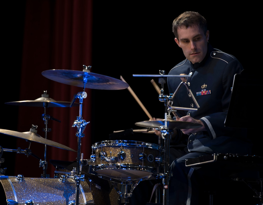 U.S. Air Force Staff Sgt. Ed Zaryky, the drummer for Offutt Brass, reads his sheet music during a performance at the Performing Arts Center Historic Theater in Rapid City, S.D., on Feb. 22, 2017. Offutt Brass is the brass ensemble of the U.S. Air Force Heartland of America Band that performs around the U.S. to celebrate America and patriotism. (U.S. Air Force photo by Airman 1st Class Randahl J. Jenson)