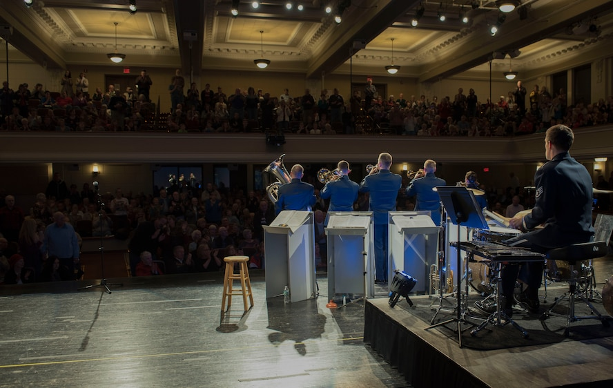 Members of the audience stand near the end of the Offutt Brass performance at the Performing Arts Center Historic Theater in Rapid City, S.D., on Feb. 22, 2017. Offutt Brass is the brass ensemble of the U.S. Air Force Heartland of America Band that performs around the U.S. to celebrate America and patriotism. (U.S. Air Force photo by Airman 1st Class Randahl J. Jenson)