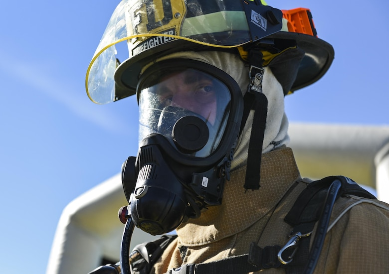 Airman 1st Class Nicholas Gough, 23d Civil Engineer Squadron firefighter, waits for the next Airman to approach the decontamination wash pit during a chemical, biological, radiological and nuclear defense exercise, Feb. 16, at Moody Air Force Base, Ga. Moody's Wing Inspection Team tested the 23d CES fire department, emergency management flight and bioenvironmental flight on procedures, response and effective communication between the units. (U.S. Air Force photo by Airman 1st Class Janiqua P. Robinson)