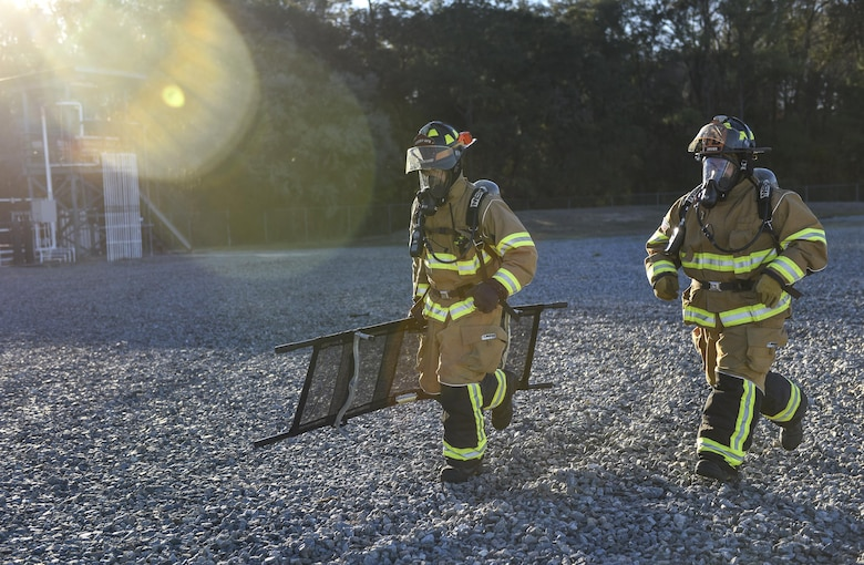 Firefighters from the 23d Civil Engineer Squadron respond to a simulated scenario during a chemical, biological, radiological and nuclear defense exercise, Feb. 16 2017, at Moody Air Force Base, Ga. Moody's Wing Inspection Team tested the 23d CES fire department, emergency management flight and bioenvironmental flight on procedures, response and effective communication between the units. (U.S. Air Force photo by Airman 1st Class Janiqua P. Robinson)