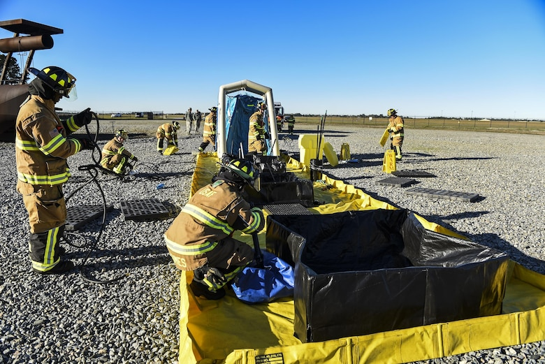 Firefighters from the 23d Civil Engineer Squadron put together a decontamination wash pit during a chemical, biological, radiological and nuclear defense exercise, Feb. 16 2017, at Moody Air Force Base, Ga. Moody's Wing Inspection Team tested the 23d CES fire department, emergency management flight and bioenvironmental flight on procedures, response and effective communication between the units. (U.S. Air Force photo by Airman 1st Class Janiqua P. Robinson)
