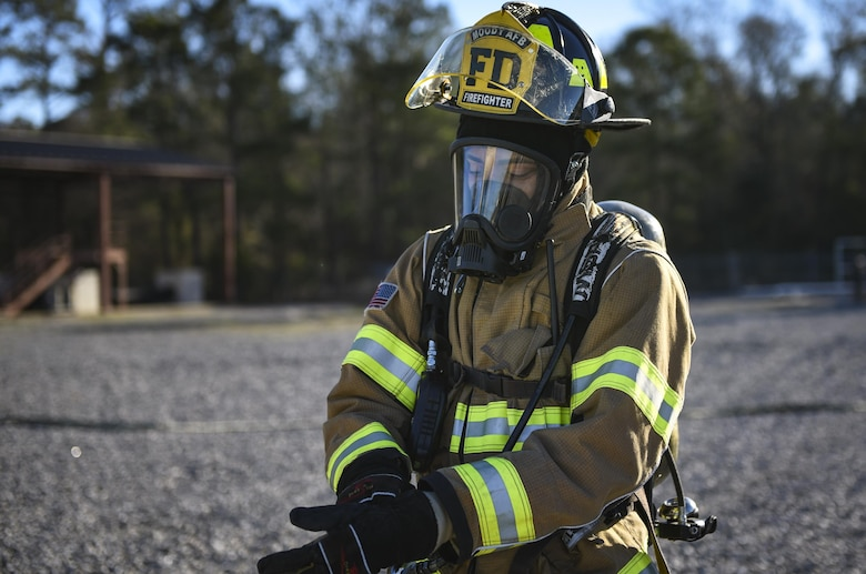 Airman Tyrell Thompson, 23d Civil Engineer Squadron firefighter, finishes donning protective gear during a chemical, biological, radiological and nuclear defense exercise, Feb. 16 2017, at Moody Air Force Base, Ga. Moody's Wing Inspection Team tested the 23d CES fire department, emergency management flight and bioenvironmental flight on procedures, response and effective communication between the units. (U.S. Air Force photo by Airman 1st Class Janiqua P. Robinson)
