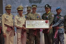 Service members from the United States, Thailand and Malaysia attend a site dedication ceremony at Ban Kok Kee San Toor, Khon Kaen Province, Thailand, during exercise Cobra Gold, Feb. 22, 2017. Cobra Gold, in its 36th iteration, focuses on humanitarian civic action, community engagement, and medical activities to support the needs and humanitarian interest of civilian populations around the region.