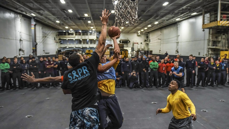 Sailors compete in a three-on-three tournament in the hangar bay of the USS Theodore Roosevelt in the Pacific Ocean, Feb. 19, 2017. Navy photo by Petty Officer 3rd Class Spencer Roberts
