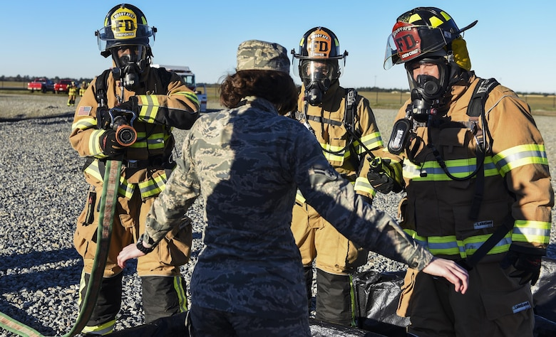 Firefighters from the 23d Civil Engineer Squadron simulate decontaminating an injured Airman during a chemical, biological, radiological and nuclear defense exercise, Feb. 16 2017, at Moody Air Force Base, Ga. Moody's Wing Inspection Team tested the 23d CES fire department, emergency management flight and bioenvironmental flight on procedures, response and effective communication between the units. (U.S. Air Force photo by Airman 1st Class Janiqua P. Robinson)
