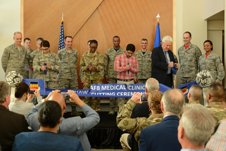 U.S. Air Force, 9th Air Force, Air Combat Command and Team Shaw members participate in a ribbon cutting ceremony for the new 20th Medical Group clinic at Shaw Air Force Base, S.C., Feb. 24, 2017. The new facility will continue to provide services offered in the previous building, to include: family health, women's health, mental health, physical therapy, optometry, pharmacy, and laboratory services. (U.S. Air Force photo by Airman 1st Class Kathryn R.C. Reaves)