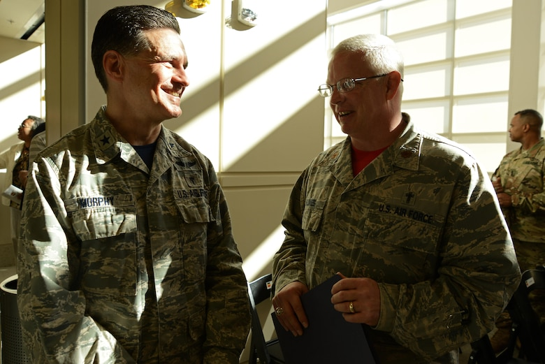 U.S. Air Force Brig. Gen. (Dr.) Sean Murphy, Air Combat Command surgeon general, left, and Chaplain (Maj.) Richard Holmes, 20th Fighter Wing deputy chaplain, right, converse after a ribbon cutting ceremony for the new 20th Medical Group clinic at Shaw Air Force Base, S.C., Feb. 24, 2017. Holmes participated in the ceremony by giving the invocation. (U.S. Air Force photo by Airman 1st Class Kathryn R.C. Reaves)
