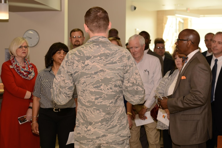 U.S. Air Force Capt. Aaron Eldridge, 20th Medical Group project health facilities officer, center, speaks to Team Shaw members and civilians during a tour of the new medical building at Shaw Air Force Base, S.C., Feb. 24, 2017. The new facility was designed to improve patient flow and help the 20th Medical Group support the medical needs of approximately 31,000 eligible beneficiaries. (U.S. Air Force photo by Airman 1st Class Kathryn R.C. Reaves)