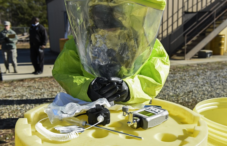An Airman from the 23d Civil Engineer Squadron bioenvironmental flight identifies hazardous material during a chemical, biological, radiological and nuclear defense exercise, Feb. 16, at Moody Air Force Base, Ga. Moody's Wing Inspection Team tested the 23d CES fire department, emergency management flight and bioenvironmental flight on procedures, response and effective communication between the units. (U.S. Air Force photo by Airman 1st Class Janiqua P. Robinson)