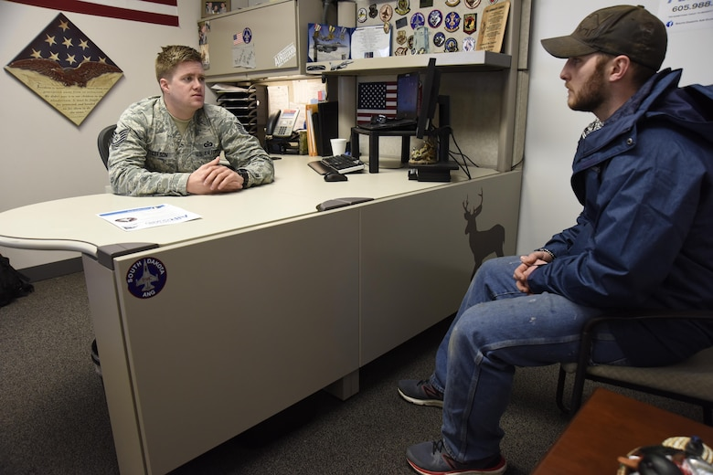 SIOUX FALLS, S.D. - Tech Sgt. Bo Ellefson, 114th Fighter Wing recruiter, speaks with James Kurtenbach, Sioux Falls native, about the benefits of membership in the South Dakota Air National Guard. Ellefson is part of a five-person recruiting team who spread awareness of the South Dakota Air National Guard mission and the benefits of joining. (U.S. Air National Guard photo by Staff Sgt. Duane Duimstra/Released)