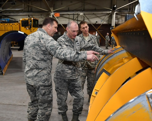"Maj. Gen. Christopher Bence, Expeditionary Center commander, and Chief Master Sgt. Larry Williams, Expeditionary Center command chief, look over the 319th Civil Engineer Squadron's winter road maintenance vehicles on Grand Forks Air Force Base, N.D., Feb. 23, 2017. Senior Airman Dylan Harrison, 319th CES pavement and equipment apprentice, provided a tour of the ""Snow Barn"" to EC leadership and explained how the equipment impacts mission operations at Grand Forks AFB.(U.S. Air Force photo by Airman 1st Class Elijaih Tiggs)"