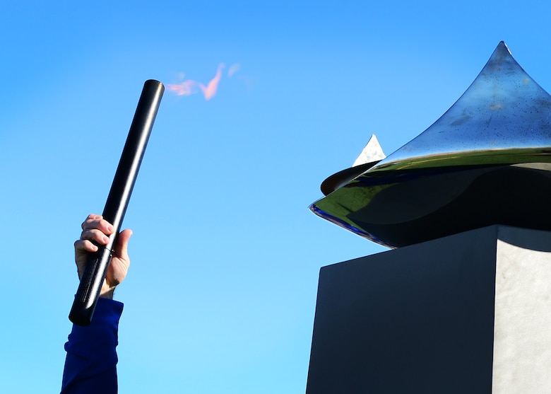 U.S. Air Force Tech. Sgt. Jason Caswell, 2017 AF Warrior Game Trials competitor, lights the cauldron during the 2017 Air Force Warrior Game Trials opening ceremony outside the Warrior Fitness Center Feb. 24, 2017 at Nellis Air Force Base, Nev. These trials are part of an adaptive sports program, headed by the Wounded Warrior Program, designed to promote the mental and physical wellbeing of seriously wounded, ill and injured military members and veterans. (U.S. Air Force photo by Senior Airman Chip Pons)