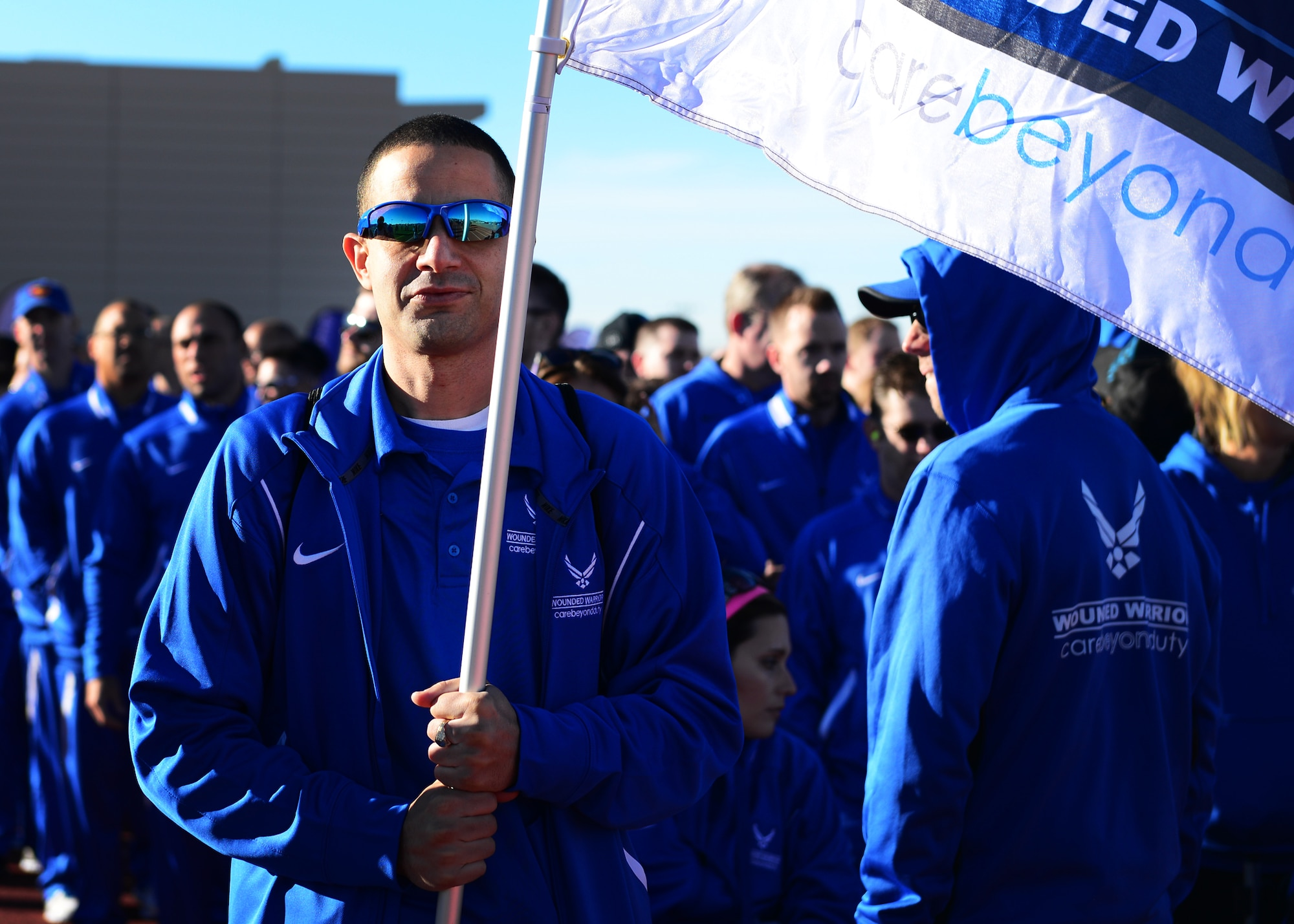 U.S. Air Force retired Tech. Sgt. Freddie Rosario, 2017 AF Warrior Game Trials competitor, carries the Wounded Warrior flag during the opening ceremony of the Air Force trials at the Warrior Fitness Center Feb. 24, 2017 at Nellis Air Force Base, Nev. Dozens of U.S. Air Force, U.S. Army, Australian and Great Britain wounded warriors gathered for the fourth annual competition. (U.S. Air Force photo by Senior Airman Chip Pons)