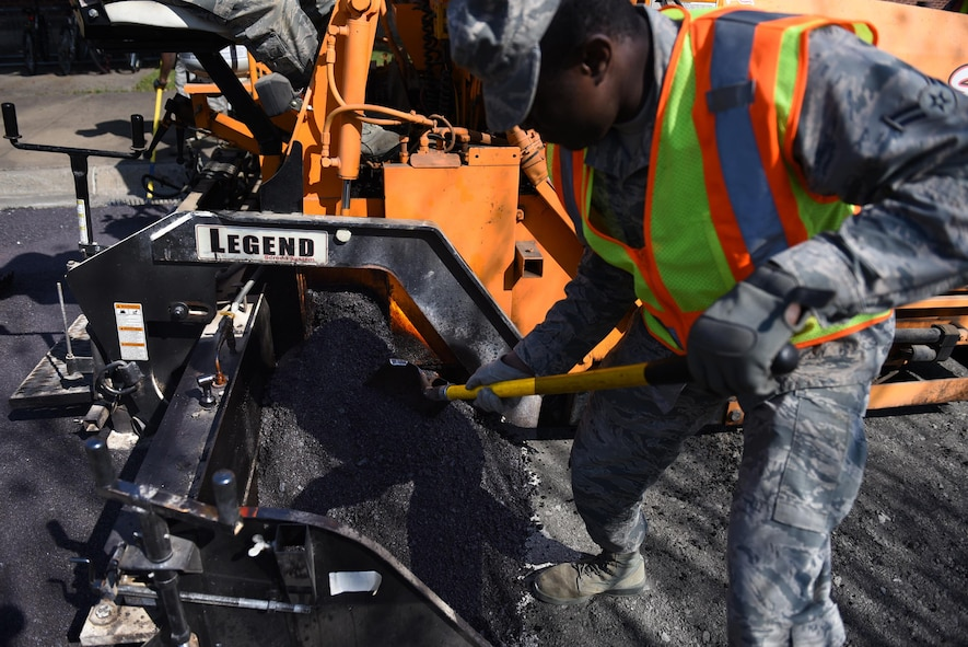 "U.S. Air Force Airman 1st Class Lawrence Amihere, 19th Civil Engineer Squadron pavement and heavy equipment journeyman, performs asphalt paving operations Jan. 7, 2017, at Little Rock Air Force Base, Ark. Airmen of the pavements and heavy equipment shop, also known as ""Dirt Boyz"", work long hours in unforgiving weather to maintain the base's airfield, roads, fences and drainage systems. (U.S. Air Force photo by Airman 1st Class Kevin Sommer Giron)"