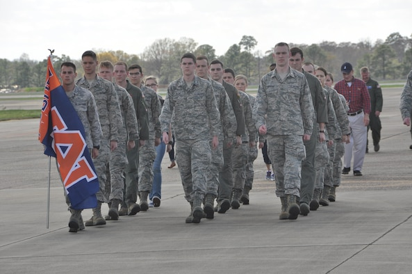 "Cadets from Auburn University's Air Force ROTC Detachment march an Auburn flag from Aircraft Tail Number 85-0040 known as ""War Eagle"" to Aircraft Tail Number 91-9142 during a Transfer of Heritage ceremony Feb. 24, at Maxwell Air Force Base.  Aircraft 91-9142, which will now carry the ""War Eagle"" legacy, came to the 908th Airlift Wing at Maxwell from the 914th Airlift Wing at Niagara Falls Air Reserve Station, New York. (U.S. Air Force photo by Bradley J. Clark)"