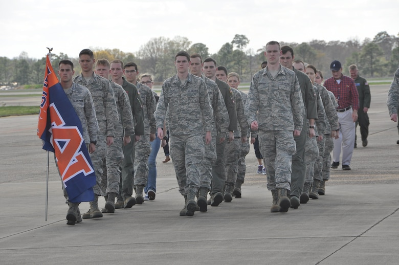 """Cadets from Auburn University's Air Force ROTC Detachment march an Auburn flag from Aircraft Tail Number 85-0040 known as """"War Eagle"""" to Aircraft Tail Number 91-9142 during a Transfer of Heritage ceremony Feb. 24, at Maxwell Air Force Base.  Aircraft 91-9142, which will now carry the """"War Eagle"""" legacy, came to the 908th Airlift Wing at Maxwell from the 914th Airlift Wing at Niagara Falls Air Reserve Station, New York. (U.S. Air Force photo by Bradley J. Clark)"""
