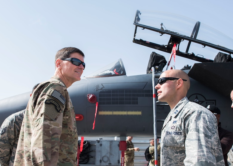 Gen. Joseph Votel, U. S. Central Command commander, receives a brief from Capt. Sheppard, 389th Aircraft Maintenance Unit officer in-charge, at an undisclosed location in Southwest Asia, Feb. 23, 2017. The general is the commander of all down-range operations in the 20-country inclusive central region in the Middle East. (U.S. Air Force photo/Staff Sgt. Eboni Reams)