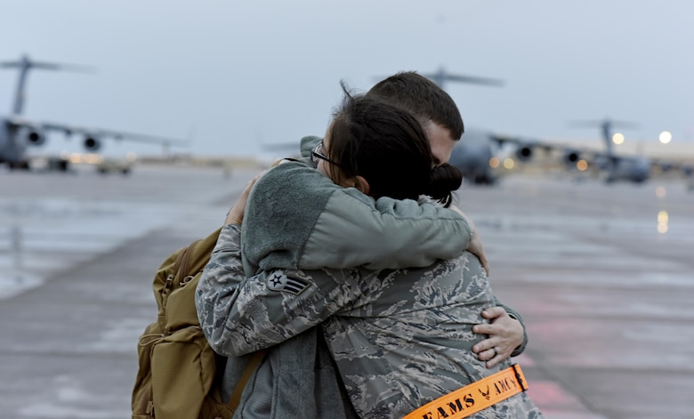 U.S. Air Force Senior Airman Sylvia Feigum, a combat oriented supply organization journeyman with the 8th Expeditionary Air Mobility Squadron, right, embraces her husband U.S. Air Force Senior Airman Matthew Feigum, a combat crew communications journeyman with the 816th Expeditionary Air Lift Squadron after marshaling in the rotator he arrived on at Al Udeid Air Base, Qatar, Feb. 16, 2017. (U.S. Air Force photo by Senior Airman Cynthia A. Innocenti)