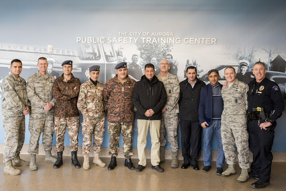 Members of the Royal Jordanian Air Force Ground Defense, Jordanian Military Security, Aurora Police Department, the Colorado Air National Guard's 233d and 140th Security Forces Squadrons collaborate on tactics and procedures for base defense in Colorado, Jan. 11-12, 2017.