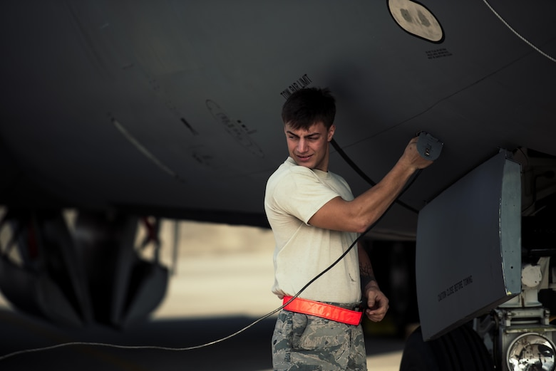 U.S. Air Force Airman 1st Class Bradley Romaker, 909th Aircraft Maintenance Unit aerospace propulsion journeyman, plugs a communications line into a KC-135R Stratotanker during maintenance Feb. 16, 2017, at Kadena Air Base, Japan. Maintainers on the flightline use the communications line to communicate from outside to inside the aircraft. (U.S. Air Force photo by Senior Airman Omari Bernard/Released)