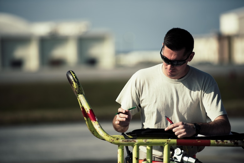 U.S. Air Force Staff Sgt. Nicholas Jaeger, 909th Aircraft Maintenance Unit aerospace propulsion craftsman, documents maintenance on the KC-135R Stratotanker Feb. 16, 2017, at Kadena Air Base, Japan. Aircraft maintainers constantly document any discrepancies and repairs performed during maintenance. (U.S. Air Force photo by Senior Airman Omari Bernard/Released)
