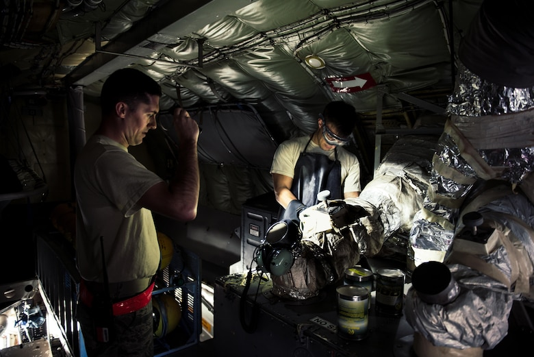 U.S. Air Force Staff Sgt. Nicholas Jaeger and Airman 1st Class Bradley Romaker, 909th Aircraft Maintenance Unit aerospace propulsion technicians, prepare an auxiliary power unit onboard a KC-135R Stratotanker Feb. 16, 2017, at Kadena Air Base, Japan. The auxiliary power unit is one method used to provide power to the aircraft while on the ground.  (U.S. Air Force photo by Senior Airman Omari Bernard/Released)