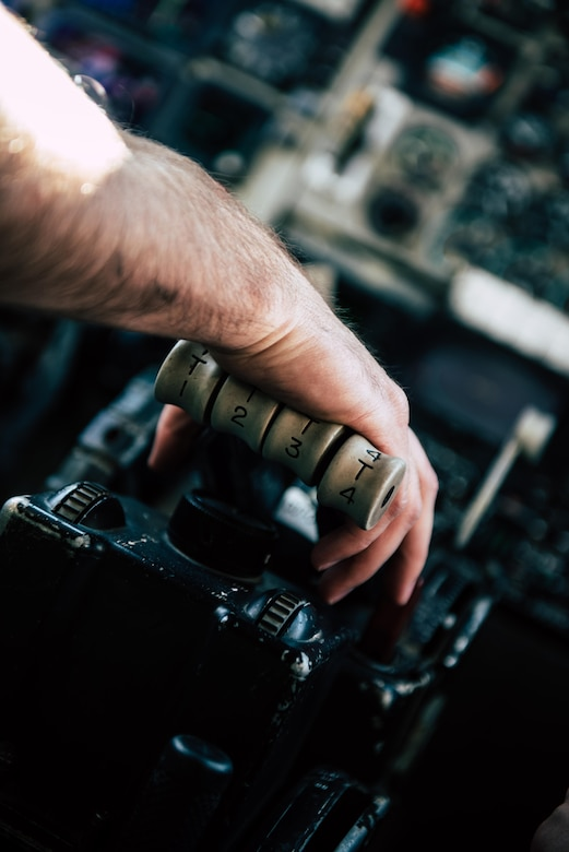 U.S. Air Force Staff Sgt. Nicholas Jaeger, 909th Aircraft Maintenance Unit aerospace propulsion craftsman, rests his hand on the throttle while performing a power run for a KC-135R Stratotanker Feb. 16, 2017, at Kadena Air Base, Japan. Jaeger pushes the engines to 80 percent power to test the aircrafts systems at high power output. (U.S. Air Force photo by Senior Airman Omari Bernard/Released)