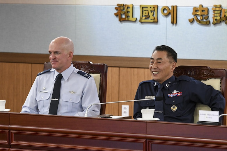 """U.S. Air Force Col. Andrew Hansen, 51st Fighter Wing commander, and Republic of Korea air force Maj. Gen. Choi, Geun Young, President of ROK Joint Forces Military University, listen to a briefing at the JFMU, Feb. 23, 2017. Hansen was invited to the JFMU to provide perspective to students, primarily in the pay grades of O-3 and O-4, and faculty about the importance of """"jointness,"""" or inter-service working relationships, in the military. (U.S. Air Force photo by Staff Sgt. Victor J. Caputo)"""