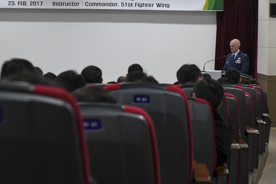 U.S. Air Force Col. Andrew Hansen, 51st Fighter Wing commander, gives a speech to a crowd of Republic of Korea military officers and instructors at the ROK Joint Forces Military University, Feb. 23, 2017. Hansen provided the students, who are pulled from the ROK air force, army and navy, a first-hand explanation of why interoperability between military branches is so vital to successful operations. (U.S. Air Force photo by Staff Sgt. Victor J. Caputo)